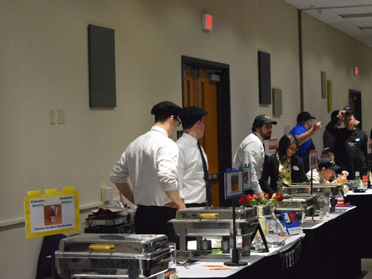 Enjoy an evening of fundraising and carefully crafted cuisine by men in our community supporting Christine Ann Domestic Abuse Services during the Men Who Cook event at the Oshkosh Convention Center Saturday, from 6 to 10 p.m. Pictured is last year's event.