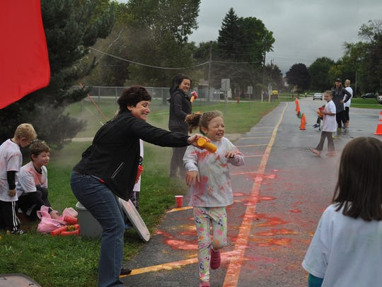 Kylie Williams getting a blast of color from Mrs. Lieser