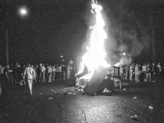 A fire burns during the Homecoming Riots in 1988. St. Cloud State beat South Dakota 14-3 during the homecoming football game.