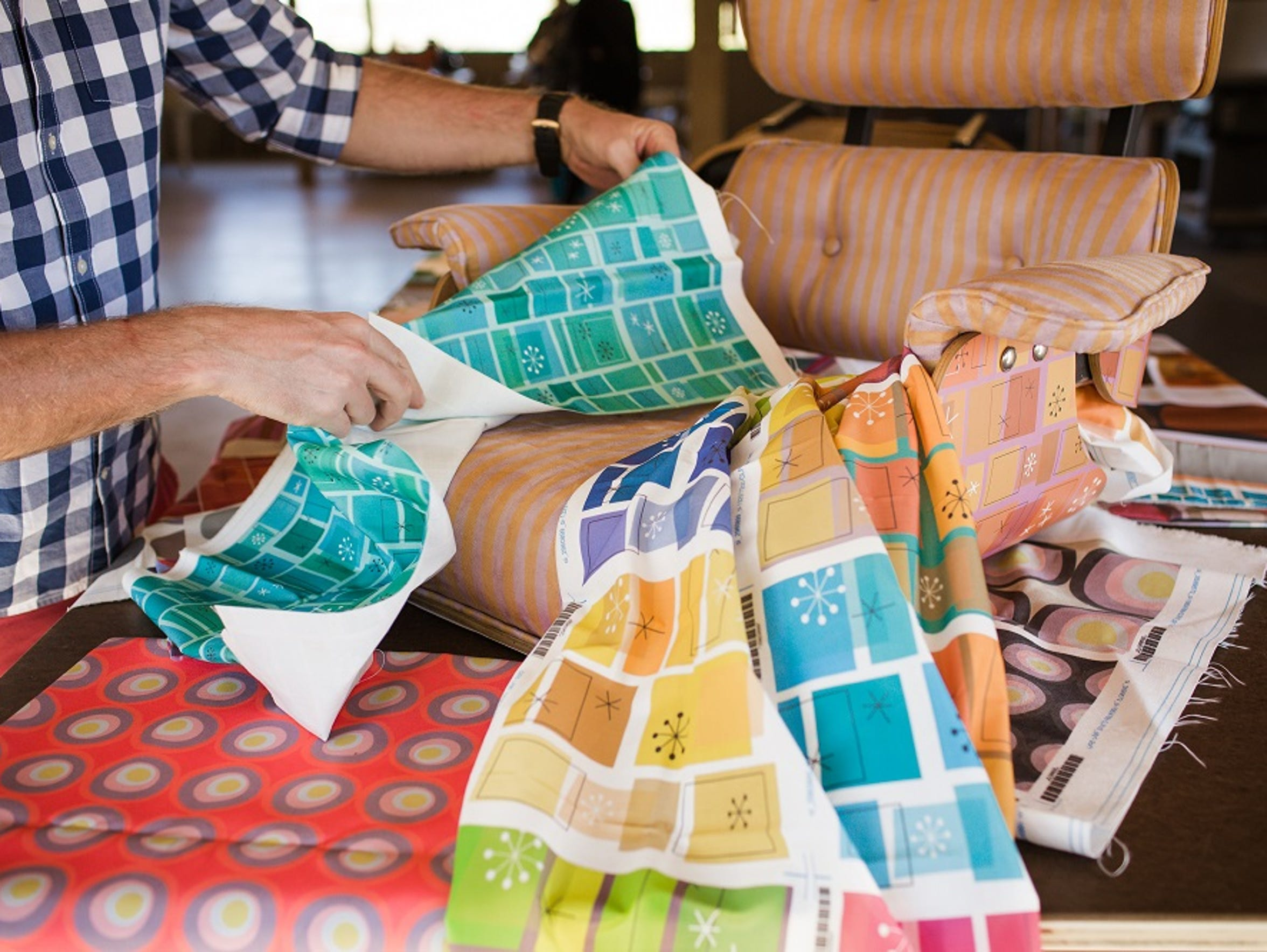 Kurt Cyr shows off his textile designs and plans to