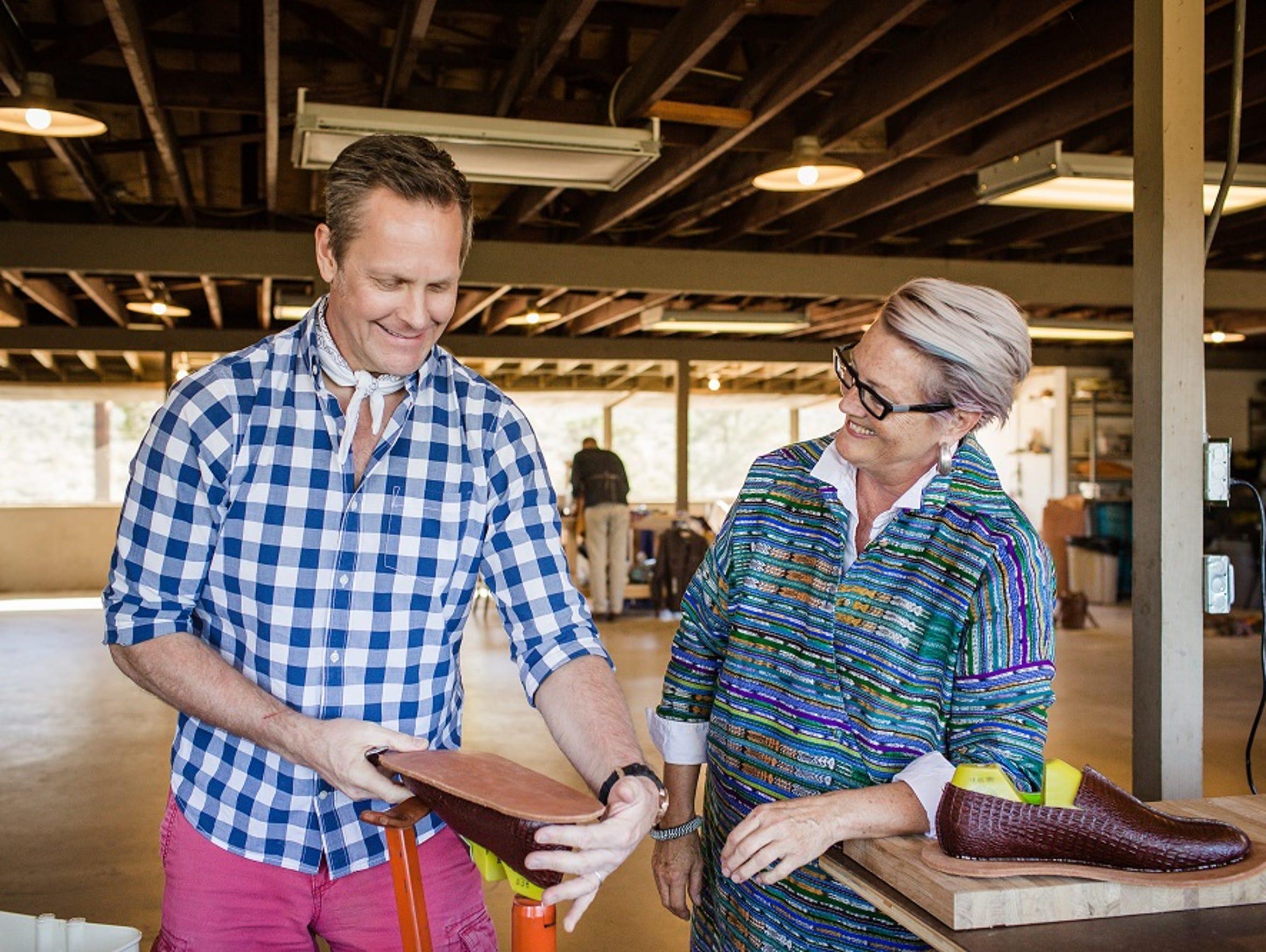Debra Hovel shows Kurt Cyr the steps in shoemaking.