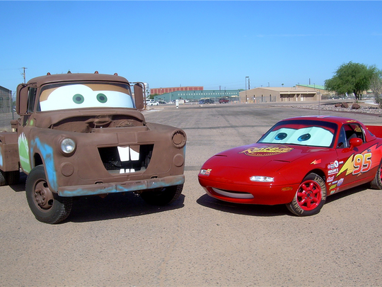 "A 1993 Mazda Miata and 1956 Dodge tow truck were customized to resemble Lightning McQueen and Tow Mater, characters from ""Cars."" They're up for auction at Barrett-Jackson on Jan. 27, 2016."