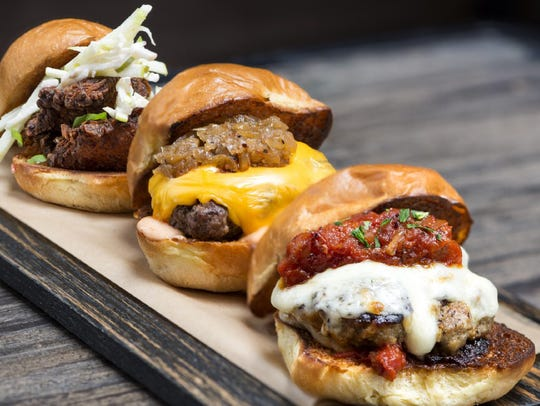 The menu at Dierks Bentley's Whiskey Row features burgers like these.