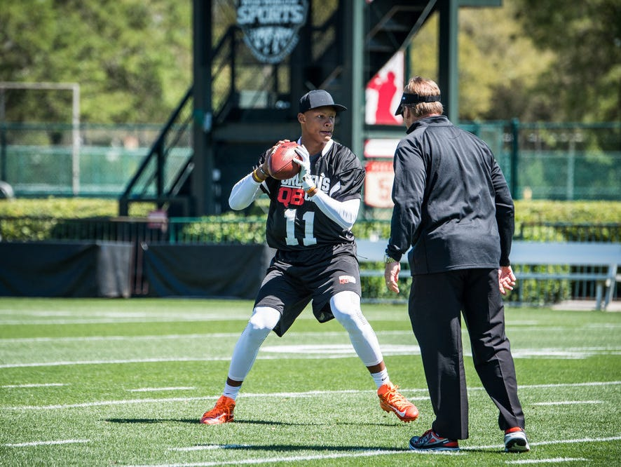 Josh Dobbs and Jon Gruden during the 2017 class at Gruden Camp
