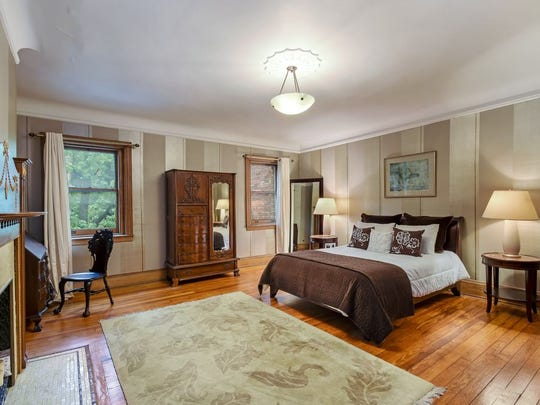There are five bedrooms, three baths, and six fireplaces with original mantels.