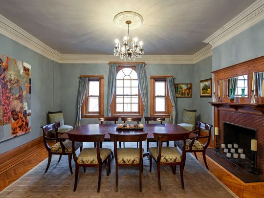 Included are five bedrooms, three baths, six fireplaces with original mantels, formal dining room, large living room with Juliette balcony, a library, inlaid hardwood floors, crown molding, wainscoting and high ceilings.