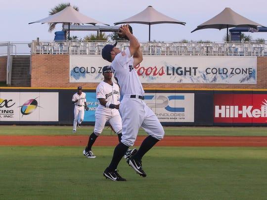 Blue Wahoos third baseman Nick Senzel (13) catches
