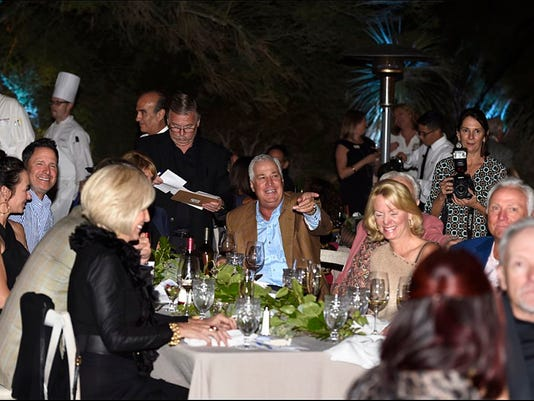 636524180091068156-Guests-enjoying-the-live-auction.jpg