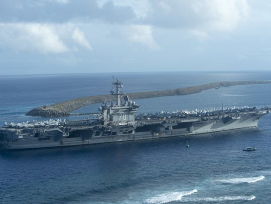 Nimitz-class aircraft carrier USS Carl Vinson pulls into Apra Harbor, Guam in January. The Vinson is scheduled to begin maintenance work at Puget Sound Naval Shipyard in 2019.