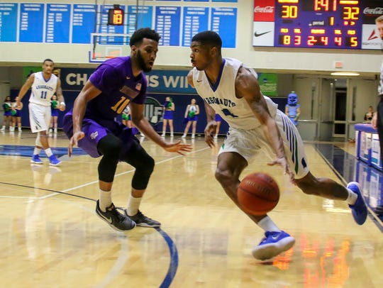 UWF's Marvin Jones (4) drives toward the baseline against