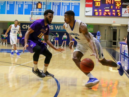 UWF's Marvin Jones (4) drives toward the baseline against Montevallo's Deshawn Jones (10) during a Gulf South Conference Tournament game at the University of West Florida Field House on Tuesday, Feb. 27, 2018. Seeded number two, UWF beat #7 Montavello 83-74.