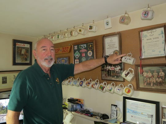Township resident Ken Fineran points out some of the