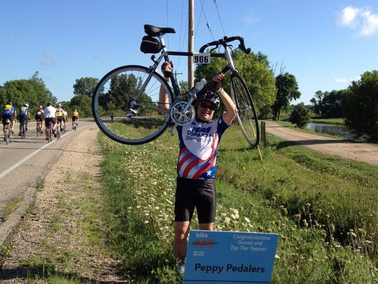 Brian Yagoda is seen lifting his bicycle at a charity ride for MS. Yagoda, a beloved doctor, was killed riding his bicycle June 14 in Delafield. The driver who struck him has been charged with homicide by negligent operation of a vehicle.