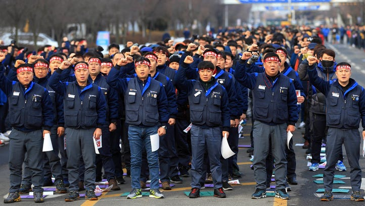 Unionized workers of GM Korea stage a rally against