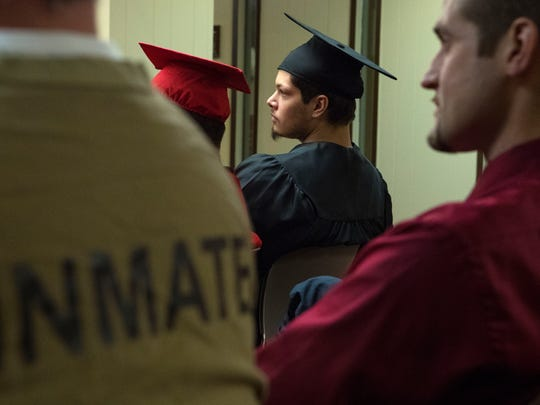 Richard Woodraska participates in his graduation ceremony after completing his General Educational Development (GED) test at the South Dakota Sate Penitentiary in Sioux Falls on Thursday, May 10, 2018.