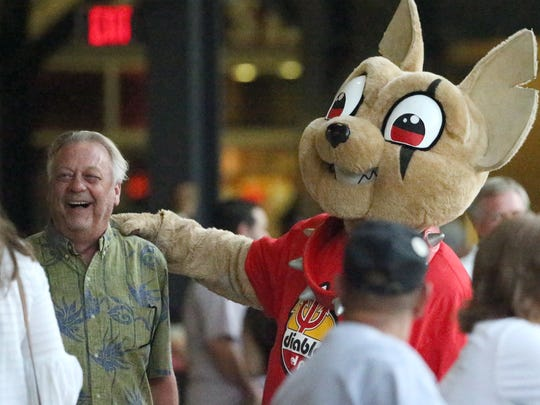 Chico poses for pictures with fans Wednesday night at Southwest University Park.