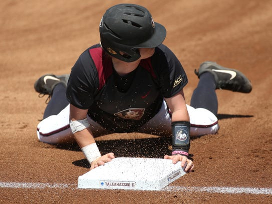 FSU's Jessie Warren slides safely into third base against