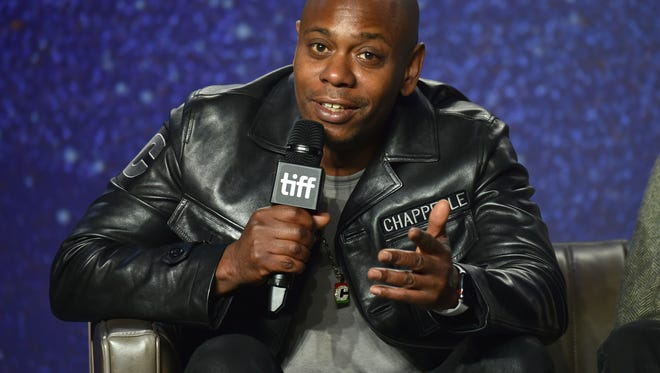 "Dave Chappelle speaks at the press conference for ""A Star Is Born."""