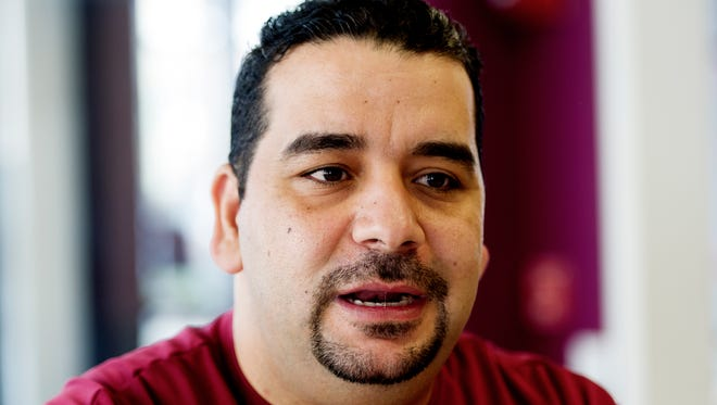 Yassin Terou, owner of Yassin's Falafel House, speaks about his reaction to U.S. airstrikes on Syria at his restaurant in downtown Knoxville, Tennessee on Friday, April 7, 2017.