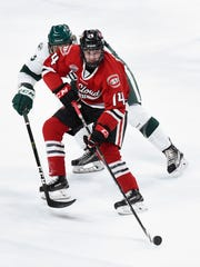 St. Cloud State's Patrick Newell, 14, makes a pass