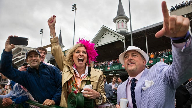 Paul D'Alessandro, from left, Suzanne WAshburn and Jeff Jankowski cheer during race nine during the Kentucky Oaks at Churchill Downs. May 5, 2017