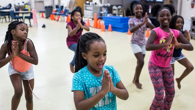 July 18, 2018 - Bayleigh Johnson, 8, center, dances along with other students during the New Ballet Ensemble and School's Summer Dance Explorers Camp. New Ballet Ensemble and School hosted their first annual Summer Dance Explorers Camp that is a two-week long, day camp event that hosts kindergarten through 5th graders.