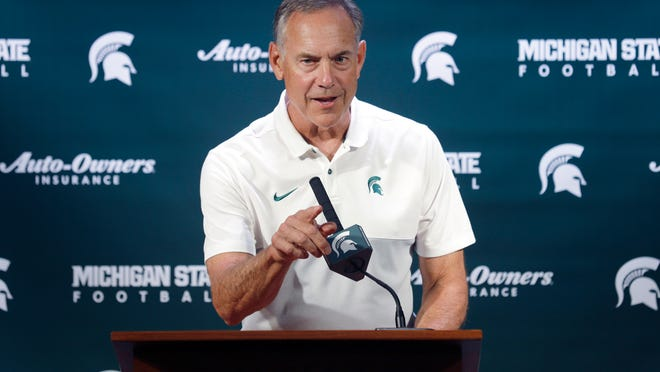 Michigan State football coach Mark Dantonio talks with reporters during the team's NCAA college football media day, Monday, Aug. 5, 2019, in East Lansing, Mich. (AP Photo/Al Goldis)