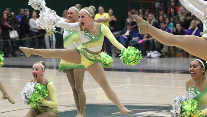 D.C. Everest's Savannah Frei leaps as she and her teammates perform Saturday at the Eastern Regional Dance Championships.