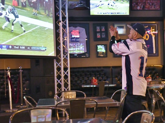 Patriots fan Jimmy Ronquillo cheers on his team during