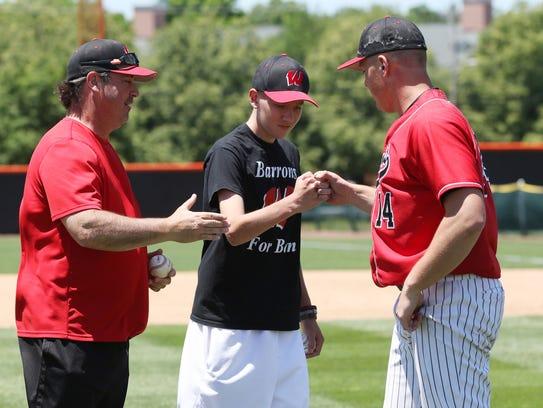 Ben Lepisto, center, is greeted by Woodbridge baseball