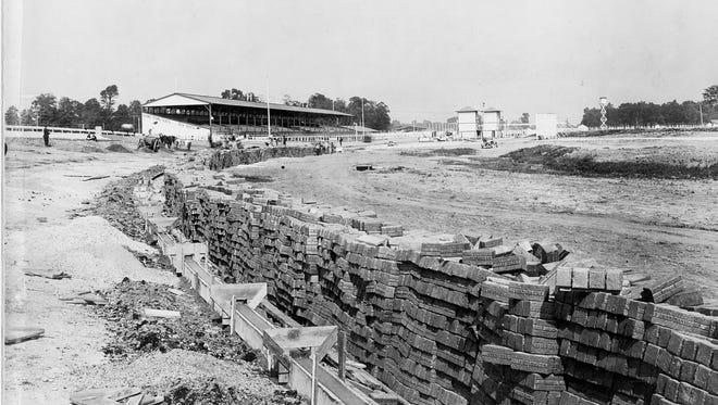 1909 photo of the resurfacing of the Indianapolis Motor Speedway with bricks.