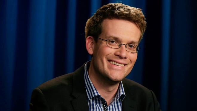 "John Green, author of ""The Fault in Our Stars,"" poses during an interview in New York on Monday, June 2, 2014."