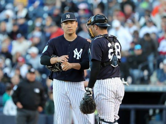 New York Yankees catcher Austin Romine (28) talks with