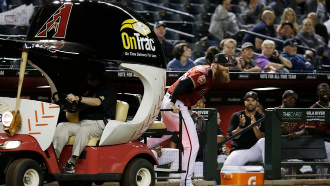 The Bullpen Cart brings out Arizona Diamondbacks pitcher Archie Bradley in the seventh inning during a game against the Cleveland Indians at Chase Field.