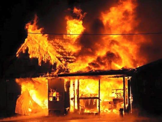 Fire destroyed a Wellsville barn Saturday evening.