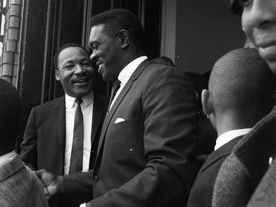 Martin Luther King Jr speaking to Williams Gary as he leaves Dexter Avenue Baptist Church in Montgomery Alabama.