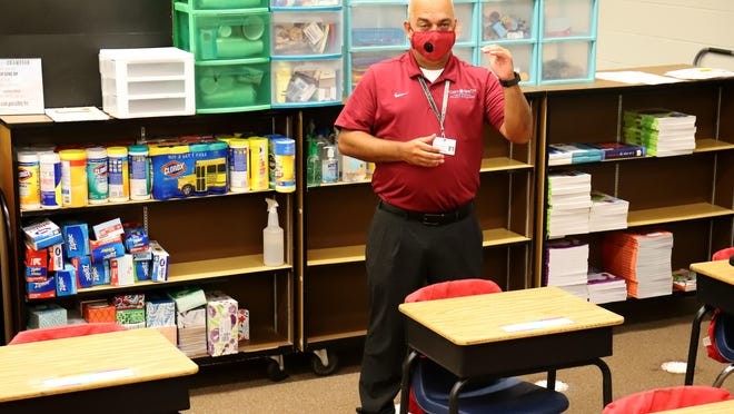 During a tour of Cook Elementary School, Shawn Shaffer, Fort Smith School District supervisor of facilities, talks about the open class room concept, Thursday, August 20, 2020, that FSPS will transition to for the 2020-2021 school year.