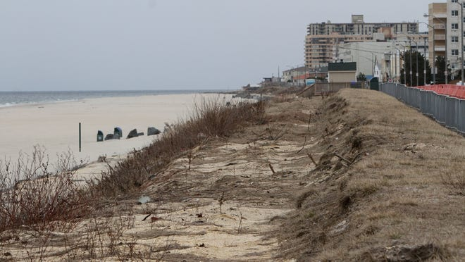 The Long Branch boardwalk is to be rebuilt on the now-bare beachfront. Work is expected to start in June and take 18 months.