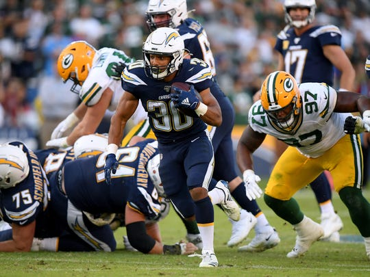 CARSON, CALIFORNIA - NOVEMBER 03:  Austin Ekeler #30 of the Los Angeles Chargers runs for a first down during the fourth quarter in a 26-11 Chargers win over the Green Bay Packers at Dignity Health Sports Park on November 03, 2019 in Carson, California. (Photo by Harry How/Getty Images)