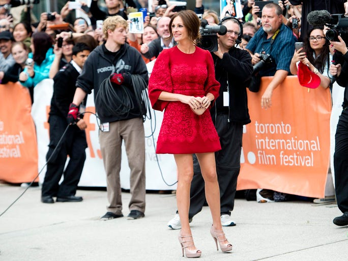 If you want to see stars, then head to the Toronto International Film Festival this week where Hollywood's best and brightest are out in full force. They're also some of the chicest celebs around. USA TODAY's Arienne Thompson rounds up the best of the best. | Julia Roberts is radiant in crimson Dolce & Gabbana.