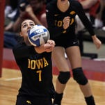 des.s0908.iowa.isu.vb -  Photo by BILL NEIBERGALL/ DES MOINES REGISTER    AMES   SEPT. 7TH , 2012 -    Iowa's #7 Alex Lovell got to the ball against Iowa State in volleyball match played at Hilton Coliseum in Ames on Friday night  Sept. 7th, 2012.    ( shot: 09/07/12)  Photo by BILL NEIBERGALL