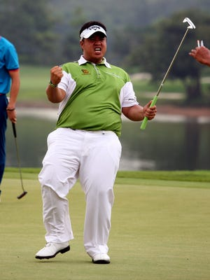 Kiradech Aphibarnrat of Thailand celebrates after winning the Shenzhen International golf tournament at Genzon Golf Club in Shenzhen, in southern China's Guangdong province on April 19, 2015.