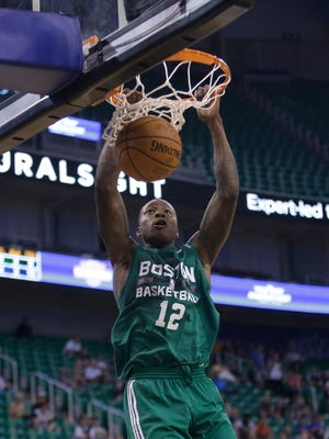 Boston Celtics' Terry Rozier (12) dunks the ball against the Philadelphia 76ers during the first half of an NBA summer league basketball game Tuesday, July 7, 2015, in Salt Lake City. (AP Photo/Rick Bowmer)