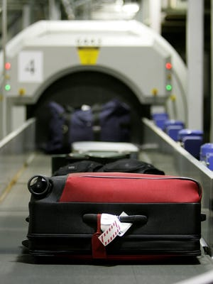 Checked luggage enters a  detection system at the Oakland International Airport June 22, 2006.