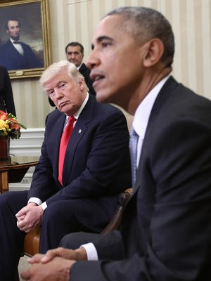 President-elect Donald Trump listens as President Obama speaks during a meeting in the Oval Office November 10, 2016.