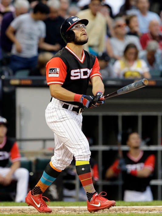Chicago White Sox's Yolmer Sanchez watches his two-run home run during the second inning of a baseball game against the Detroit Tigers, Saturday, Aug. 26, 2017, in Chicago. (AP Photo/Nam Y. Huh)