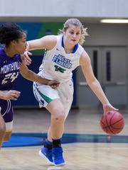 Danielle Norquest (15) brings the ball up court during the Montevallo vs UWF women's basketball game at the University of West Florida in Pensacola on Monday, December 18, 2017.