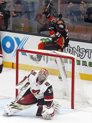 Anaheim Ducks right winger Jakob Silfverberg (33) celebrates his goal over Arizona Coyotes goalie Antti Raanta (32) in the third period of an NHL hockey game in Anaheim, Calif., Sunday, Dec. 31, 2017. The Ducks won, 5-2.