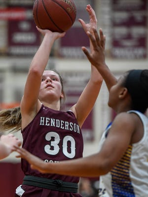 Henderson's Emilee Hope (30) takes a jump shot in the paint as the Henderson County Lady Colonels play the Caldwell County Lady Tigers in the Second Region Tournament in Dixon Tuesday, February 27, 2018.
