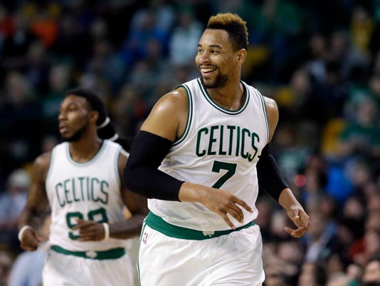 Boston Celtics center Jared Sullinger (7) smiles after scoring against the Milwaukee Bucks in the second half of an NBA game, Friday, April 8, 2016, in Boston. The Celtics won 124-109. At left is Celtics forward Jae Crowder. (AP Photo/Elise Amendola)